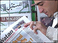 Reader at newspaper stand, Algiers