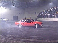A car spins in the middle of the arena