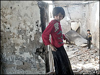 Children searching a police station burned down in Korasuv (15/5/2005)