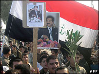 Supporters of Saddam Hussein rally in Dur, near Tikrit