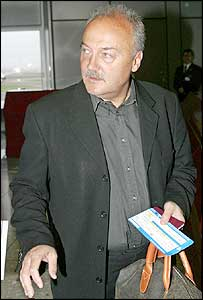 George Galloway at Heathrow Airport before departing for the US