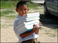 Baan Nam Khem pupil with schoolbooks