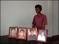 Desha Nuansang with photographs of just some of his relatives who died in the tsunami