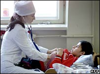 A Chechen doctor inspects a girl in a children's hospital on 21 December 2005