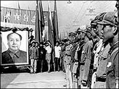 Red guards line up in Peking in front of Mao portrait