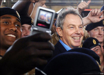 Soldiers cheer on Tony Blair