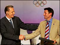 IOC president Jacques Rogge congratulates London bid leader Lord Coe in Singapore 