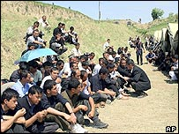 Uzbek refugees from Andijan sit in a refugee camp near Jalal-Abad region, some 600 kilometres (370 miles) south of the capital Bishkek, at the border with Uzbekistan, Monday, May 16, 2005.