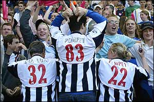Fans of Saints' rivals Portsmouth celebrate West Brom's survival