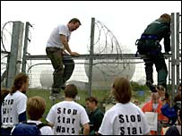 Protesters scale the fence at Menwith Hill in 2001
