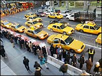 People queue for taxis in New York City