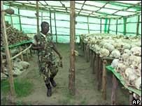 A soldier looks at skulls in Rwanda (file photo, 1999)