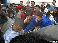 Palestinian youths try to touch Ronaldo (left) in Ramallah