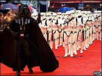 Darth Vader leading Stormtroopers down the red carpet