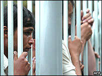 Local residents watch the funeral of victims in the Uzbek town of Andijan