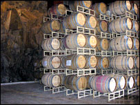 Barrels of wine held on wooden racks
