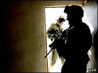 US soldiers raid a house in the Iraqi city of Hawija