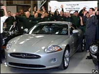 Workers cheer as first Jaguar XJ rolls off production line in Birmingham