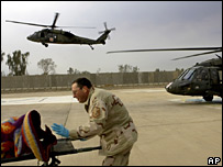 A US airman unloads a wounded Iraqi soldier from a helicopter