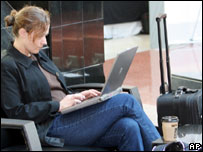 Woman using laptop, AP