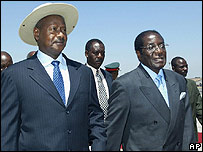 President Museveni (l) with President Mugabe (r) in 2004