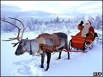 Santa and one of his trusty reindeer in Lapland