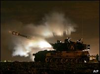 Israeli army artillery fires a shell toward the northern Gaza Strip