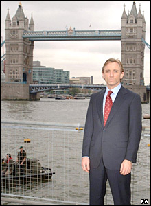 Daniel Craig poses by Tower Bridge after being unveiled as the new James Bond