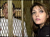 Ayman Nour behind bars and his wife, Gameela Ismail