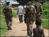 Peacekeepers walk through Raviart