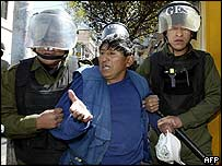 Police detain protester in La Paz on 16 May