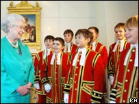 The Queen with choristers from Her Majesty's Chapel Royal who appear in her Christmas Day broadcast