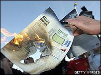 Fan burns Man Utd season ticket application outside Old Trafford