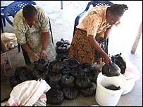 Staff at the Nuru centre sorting rice for clients