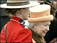 A member of the Royal Canadian Mounted Police with the Queen