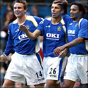 Gary O'Neil (centre) is congratulated by Matthew Taylor (left) and Dario Silva