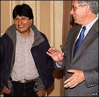 Evo Morales (L) chats to outgoing President Eduardo Rodriguez on Tuesday