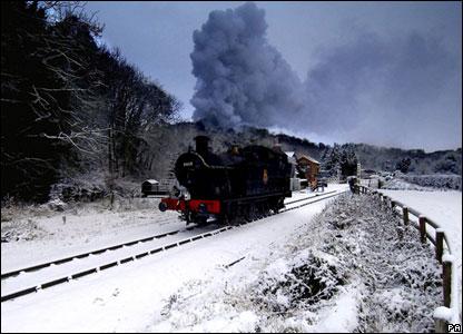 North Yorkshire Moors steam train runs through the snow