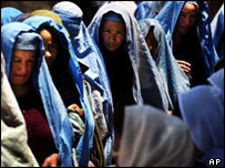 Afghan women queue up at a Care International food distribution centre in Kabul.