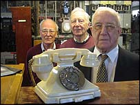 Pensioners with an old fashioned telephone