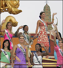Contestants ride a parade float on Friday, 13 May 2005