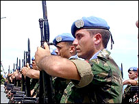 Nearly 800 of Portuguese United Nations peacekeepers, leaving from East Timor, line up to receive their U.N. service medals in Dili, Saturday, Feb. 3, 2001.