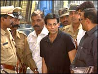 Abu Salem, flanked by police officers, is taken to a laboratory in Bangalore