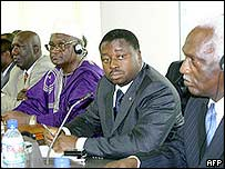 Togo's President Faure Gnassingbe (centre) and his team at the talks in Abuja