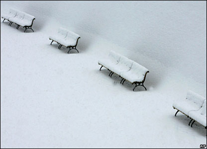 Benches covered by snow in Berlin, Germany