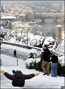 A child slides down an icy street in Florence