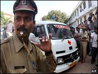Police in Bangalore guard ambulance carrying body of murdered Prof MC Puri
