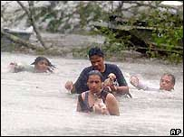 People being swept away by flooding during Hurricane Katrina