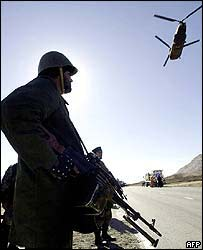 US soldier and helicopter in Afghanistan