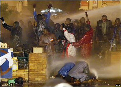 Sudanese protesters braving water cannon